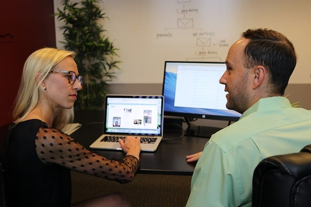 Colleagues examining two website layouts