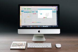 Apple desktop with multiple windows open