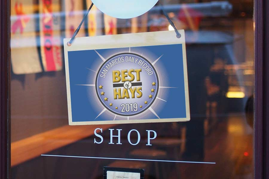 A store window with a Best of Hays sign