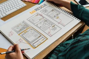A mobile-first web design mockup drawn on paper
