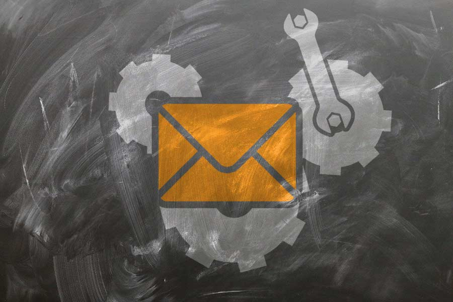 Illustration of an envelope with cogs being fine-tuned by a wrench