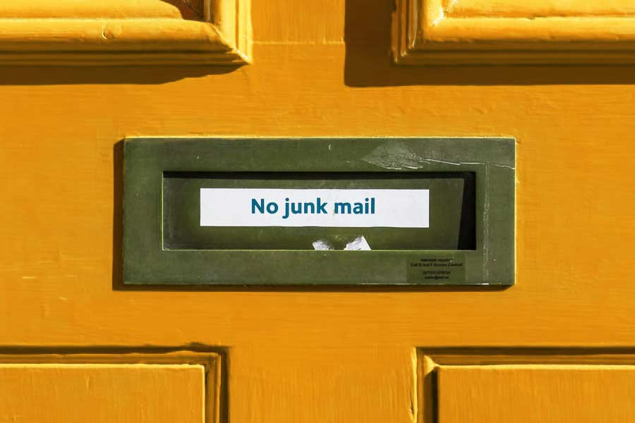 "Mail slot on a door with the label ""No junk mail"""