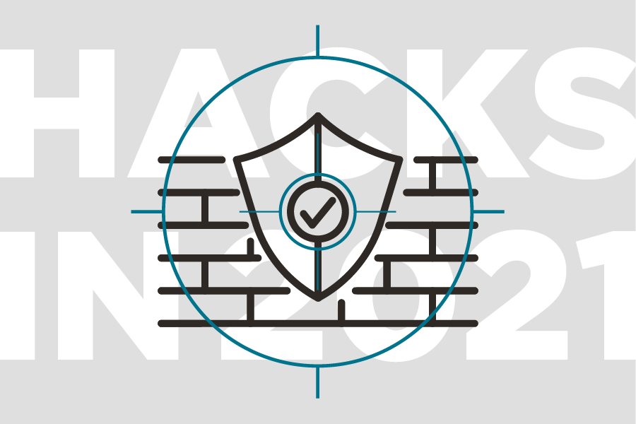 A security shield in front of a wall signifying a firewall and security.