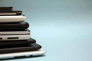 Stack of smartphones of various sizes