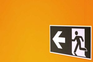 Exit sign on an orange wall